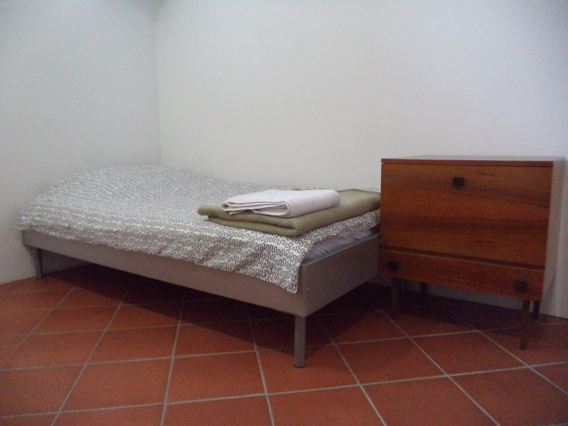A prepared bed in the second bedroom, ready for our guests (large apartment).