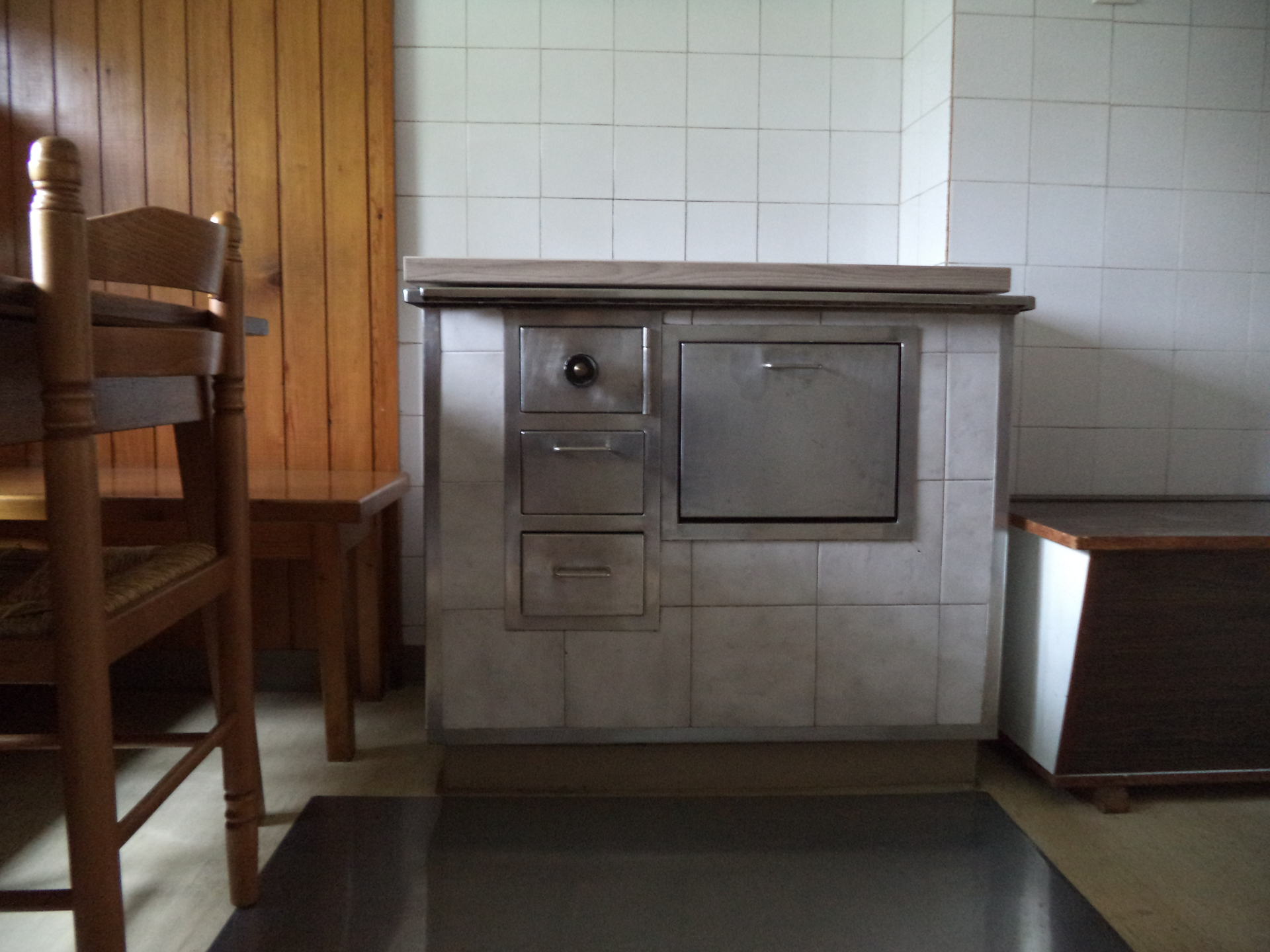 The old stove in the kitchen will heat the place up during winter time. Never fear, there is a regular stove for cooking as well (rustic apartment).